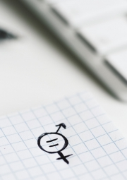 a symbol for gender equality drawn in a piece of paper, placed on an office desk
